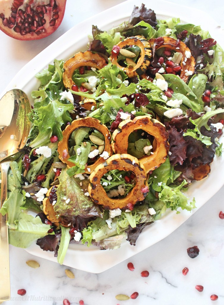 Sweet and Savory Delicata Squash Salad | C it Nutritionally A satisfying salad full of fall flavors, this Sweet and Savory Delicata Squash Salad has warm roasted delicata squash with a hint of cinnamon, a burst of tart pomegranate seeds, sweet dried cranberries, and a delicious light and creamy dressing! Gluten Free | Grain Free | Nut Free | Soy Free | Vegan and Dairy Free options